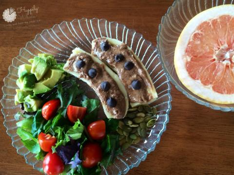 Healthy Lunch 5: Grapefruit, banana with almond butter and chocolate chips, salad, pumpkin seeds