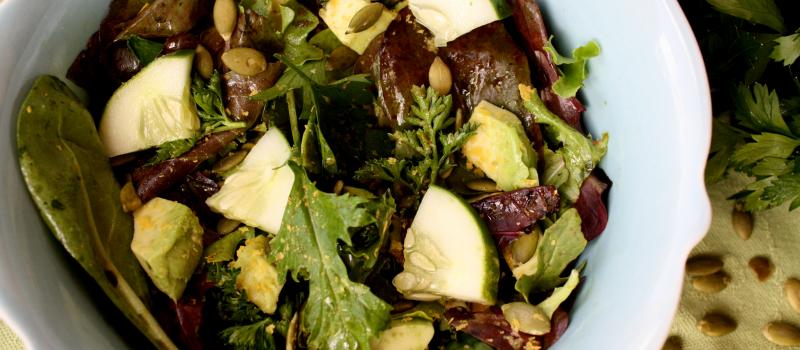 Pumpkin seed, herb, avocado and mixed green salad